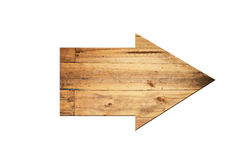 Directional arrow made of old wood surface. Stock Images