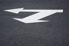 Directional arrow sign on asphalt Royalty Free Stock Image
