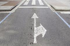 Directional arrows on the asphalt Stock Photo
