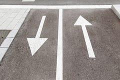 Directional arrows on the asphalt Stock Photography