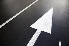 Directional arrows on the road Stock Image