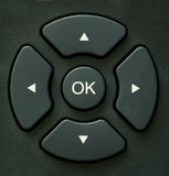 Directional buttons. Detail of a remote control's directional buttons, with OK button in center Royalty Free Stock Image