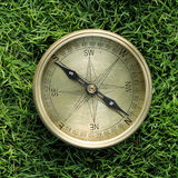 Directional compass in grass Stock Image