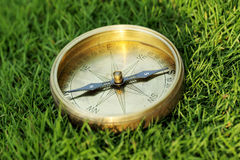 Directional compass in grass Royalty Free Stock Photo