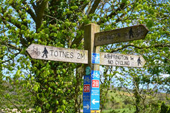 Directional Footpath Sign Along a English Countryside. This is a sign I came across during my river walk from Ashprington to Totnes Devon UK. Britain is truly a Royalty Free Stock Images