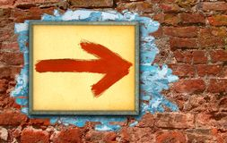 Directional sign. Against old painted brick wall dating centuries royalty free stock photography