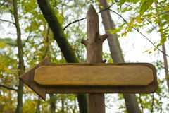 Directional sign. To the left in a forest royalty free stock photo