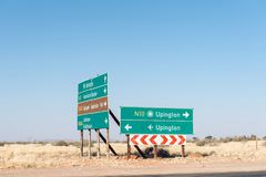 Directional sign boards at the N10 and R360 junction, Upington. Directional sign boards at the junction between the N10 and R360 roads at Upington, a town in the stock photo