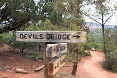 A directional sign on the Devil`s Bridge trail. A sign leading you to the natural arch, Devil`s Bridge, in Sedona, Arizona Stock Images