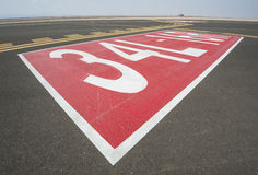 Directional sign markings on a runway Royalty Free Stock Photo