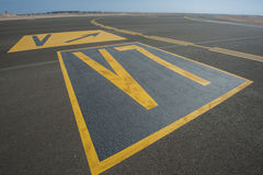 Directional sign markings on a runway Stock Photos