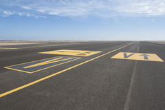 Directional sign markings on a runway Stock Photography