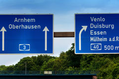 Directional sign on the motorway A 3. Highway sign, directional sign on the motorway A 3, direction Venlo, Duisburg, Essen, Muelheim an der Ruhr, Oberhausen royalty free stock images