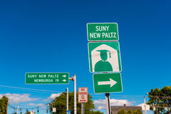 Directional Sign to SUNY New Paltz. A public college with about 7,500 attending students in New Paltz, upstate New York, USA. SUNY means State University of Royalty Free Stock Images