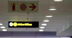 Directional signs at airport terminal. Directional signs for passengers at airport terminal stock footage