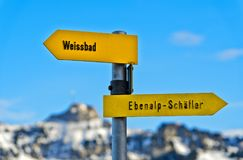 Directional signs pointing in opposite directions Stock Images