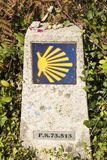 Directional signs on saint james way. Scallop shell and yellow arrow with blue background on a wall. Camino de santiago Royalty Free Stock Photography