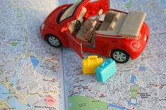 Directions?. A (toy) car and suitcases on map of Paris Royalty Free Stock Images