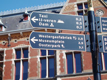 Directions at Amsterdam centraal Stock Photo