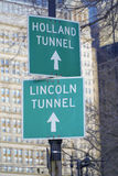 Directions signs to Holland Tunnel and Lincoln Tunnel in Manhattan- MANHATTAN - NEW YORK - APRIL 1, 2017 Royalty Free Stock Photography