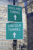 Directions signs to Holland Tunnel and Lincoln Tunnel in Manhattan- MANHATTAN - NEW YORK - APRIL 1, 2017 Royalty Free Stock Photos