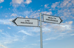 Directions to life and health insurance. Road signs to life and health insurance Stock Photos