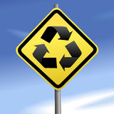 Directions to recycle on yellow traffic sign sky Stock Photos