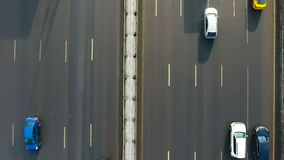 Directly above - cars moving on a road, bridge in winter. Top view from copter. stock footage