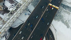 Directly above -cars moving on a road, bridge in winter. Top view from drone. stock video footage