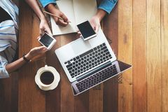 Directly above of hipster lifestyle and creative workspace in cafe. Business women teamwork with laptop, mobile phone in coffee shop. startup online marketing Royalty Free Stock Photos