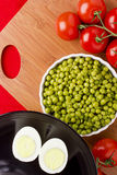 Eggs, Peas, and Tomatoes Stock Photos