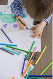 Directly above shot of boy drawing at home Royalty Free Stock Photos