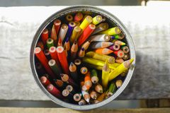 Directly above shot of color pencils on the wooden table royalty free stock images