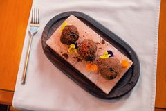 Funny truffles on plate. Directly above of truffles on plate, arranged by colorful flowers and various spices stock images