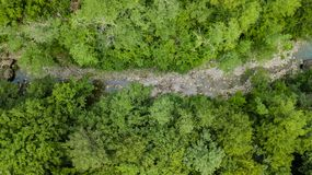 Aerial Top Down View Of Caucasus Mountains Forest Trees. stock photo