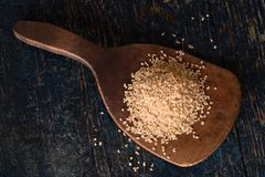 Dried Bulgar on a wooden paddle. Directly above a wood paddle with a heap of dried burger royalty free stock image