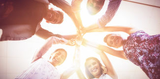 Directly below portrait of business people raising hands royalty free stock photo