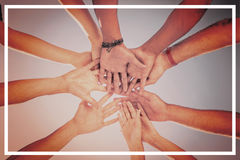 Directly below shot of friends stacking hands. Against clear sky Royalty Free Stock Photos