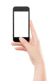 Directly front view of a modern black mobile smart phone in female hand stock image