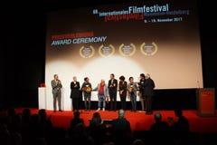 Director Bagane Fiola at mic got a price at the Internationales Filmfestival Mannheim-Heidelberg 2017. Mannheim/Heidelberg, Deutschland, 2017-11-18. Der Special Royalty Free Stock Photography