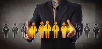 Director Building A Mixed Gender Management Team. Blue chip recruitment manager selecting a group of five employees in a lineup of worker icons. Business concept stock photography