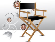 Director chair. Wooden foldable Director chair and floral background Stock Images