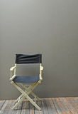 Director Chair. Director wood Chair and wall Royalty Free Stock Images