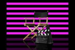 Director Chair, chapaleta de la película y megáfono delante de pelado imagen de archivo libre de regalías