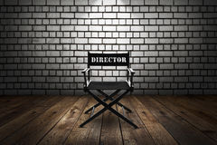 Director chair. In front of a brick wall royalty free stock image