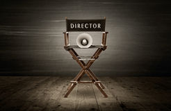 Director chair. And megaphone, scene in dark room royalty free stock images