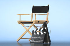 Director Chair, Movie Clapper and Megaphone. On a blue background Stock Images