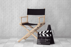 Director Chair, Movie Clapper and Megaphone. 3d Rendering. Director Chair, Movie Clapper and Megaphone in front of Brick Wall. 3d Rendering Royalty Free Stock Image