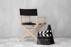 Director Chair, Movie Clapper and Megaphone. 3d Rendering. Director Chair, Movie Clapper and Megaphone in front of Brick Wall. 3d Rendering Stock Photos