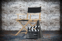 Director Chair, Movie Clapper and Megaphone. 3d Rendering. Director Chair, Movie Clapper and Megaphone on a grunge background. 3d Rendering Stock Image